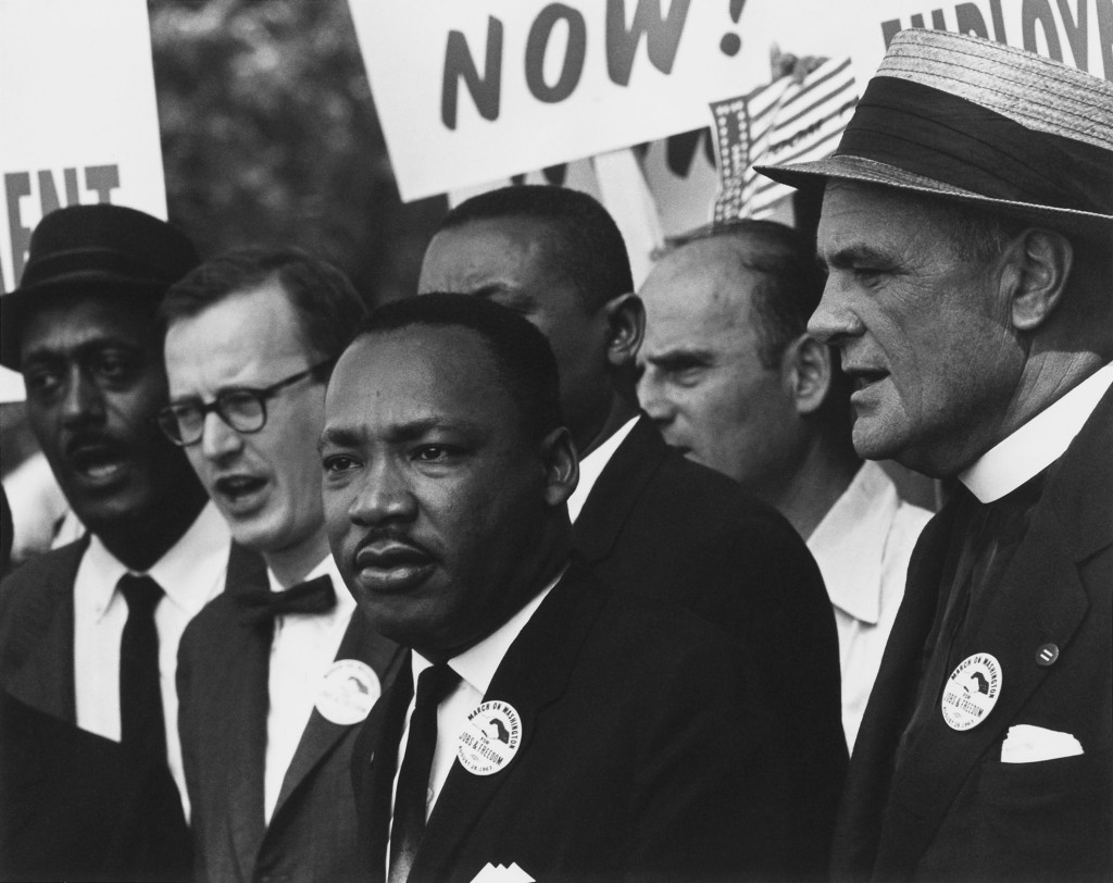 https://upload.wikimedia.org/wikipedia/commons/thumb/1/15/Civil_Rights_March_on_Washington%2C_D.C._%28Dr._Martin_Luther_King%2C_Jr._and_Mathew_Ahmann_in_a_crowd.%29_-_NARA_-_542015_-_Restoration.jpg/1280px-Civil_Rights_March_on_Washington%2C_D.C._%28Dr._Martin_Luther_King%2C_Jr._and_Mathew_Ahmann_in_a_crowd.%29_-_NARA_-_542015_-_Restoration.jpg