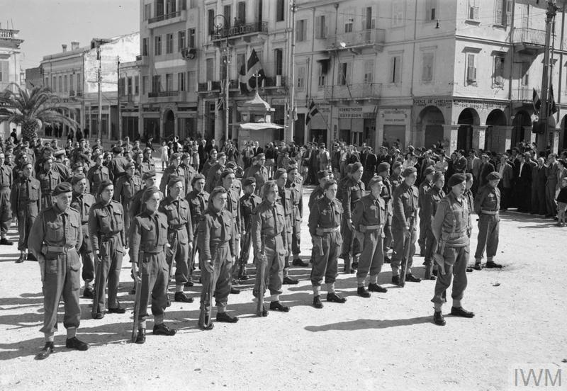ROYAL AIR FORCE: ITALY,THE BALKANS AND SOUTH-EAST EUROPE, 1942-1945. (CNA 3172) Officers and airmen of No. 2908 Field Squadron RAF Regiment, drawn up for inspection by the Commander-in-Chief, Land Forces Adriatic, on the quayside at Patras, Greece, after liberating the town on 2 October 1944. Copyright: © IWM. Original Source: http://www.iwm.org.uk/collections/item/object/205209414
